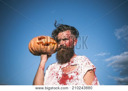 Halloween Zombie With Red Blood And Bloodstains On Blue Sky