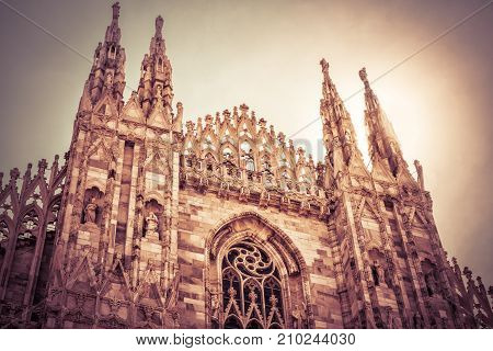 The famous Milan Cathedral (Duomo di Milano) on a sunny day in Milan, Italy. Milan Duomo is the largest church in Italy and the fifth largest in the world.