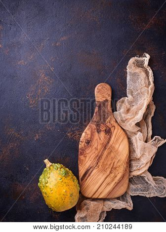 Empty wooden cutting board on old rusty background. Top view