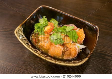 Delicious portion of fresh salmon fillet with aromatic herbs spices and vegetables - healthy food diet or cooking concept