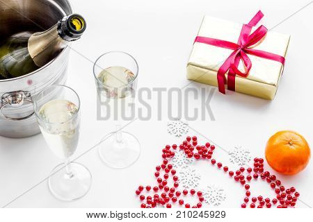 New Year 2018 background. Champagne in bucket, glasses with beverage and decoration on white background.