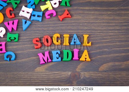 social media. various colored wooden letters on a dark plate.
