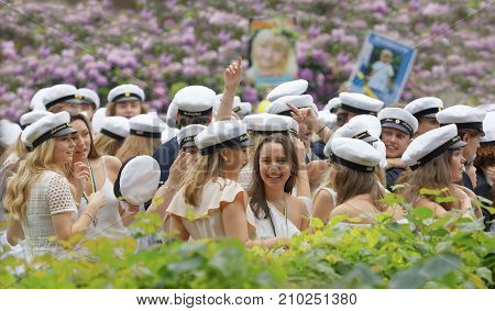 STOCKHOLM SWEDEN - JUN 13 2017: Happy swedish graduating students in a beautiful park with lilac flowers in the background at the dance school Balettakademien June 13 2017StockholmSweden