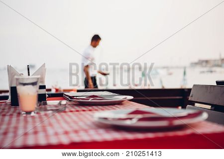reserved table in a cafe outdoor in summer