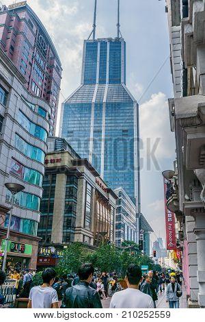 Shanghai, China - Nov 4, 2016: On Nanjing Road Pedestrian Street - Modern buildings in western architectural designs line the metropolitan area.