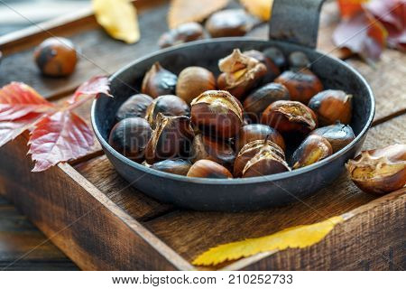 Roasted Chestnuts In A Cast Iron Skillet.