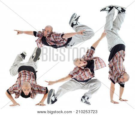 Collage with four poses breakdancer (one model) isolated on white background.