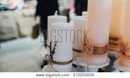 .beautiful Wax Candles In Boho Style Close-up. .colored Wax Candles For Spa