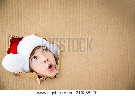 Funny Kid Looking Through Hole On Cardboard