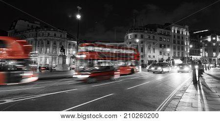 Vibrant London night scene at Trafalgar Square