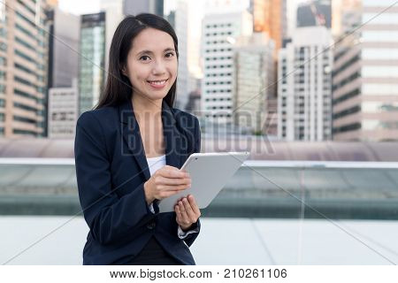 Business woman using tablet computer in Hong Kong