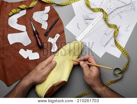 Modelling Design Of A Shoes.workplace Of Shoe Designer.hands Of Designer Draw A Shoe Design .copy Sp