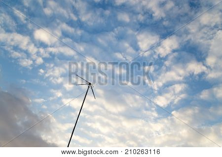 antenna on a background of the sky with clouds .