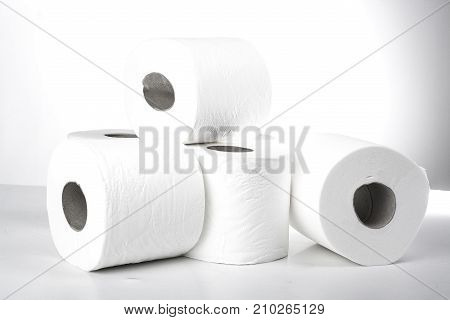 Toilet paper. Wc paper rolls. Toilet Tissue paper roll. The reel of the toilet paper on the white background. Roll of toilet paper- Cheap wc wiping paper product hygienic purposes. Rolls of toilet paper. Wc papers.