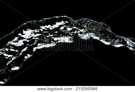 stream of water on a black background .