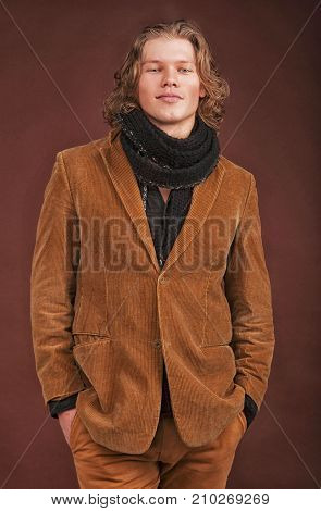 Man In  Jacket  Isolated On Brown Background