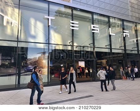 Stuttgart, Germany - October 14, 2017: People are passing the Tesla Motors showroom in Stuttgart, Germany.