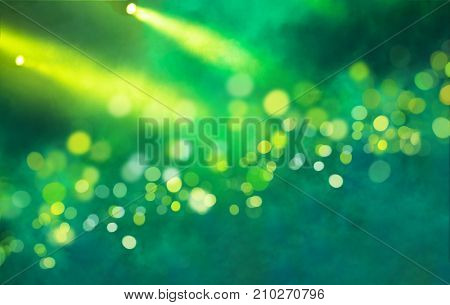 Stage light projector and yellow glitter lights on green background. Abstract Spotlight Glitter lights background.