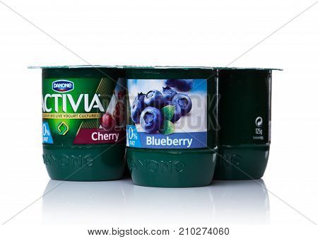 London, Uk - October 20, 2017: Pack Of Activia Yogurt With Cherry And Blueberry On White. Activia Is