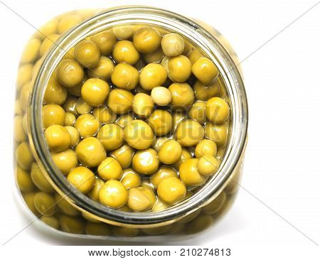 peas in a pot on white background .