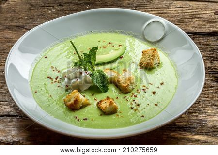 Fresh, Delicious, appetizing soup on background in cafe