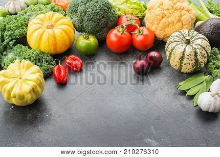 Top view of vegetables on the dark grey black background, copy space for text below, selective focus