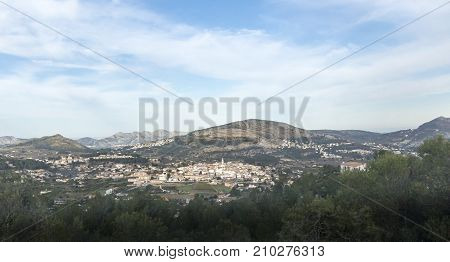 View of the city of Parcent below the Coll de Rates mountains in in the Vall de Pop Alicante Spain