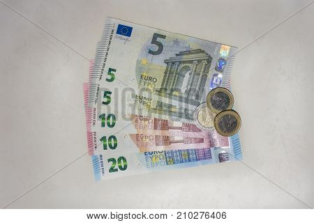 A selection of euro bank notes and coins