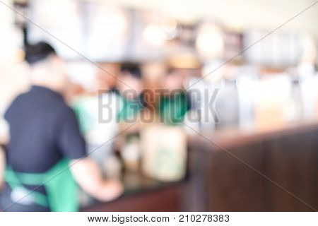 Blurred barista working at coffee bar background food and drink business