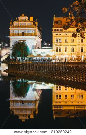 View Of Smetana Hall And Vltava River At Night In Prague, Czech Republic