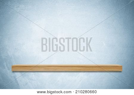 Empty wooden shelf on blue cement wall background product display montage