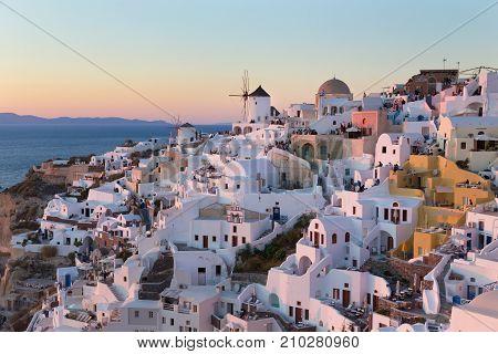World famous Oia village or Ia at sunset, Santorini island, Greece.