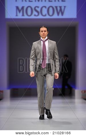 MOSCOW - FEBRUARY 22: A model wears suit and tie from Slava Zaytzev and walks the catwalk in Collection Premiere Moscow, leading fashion fair in Eastern European market, on February 22, 2011 in Moscow, Russia.