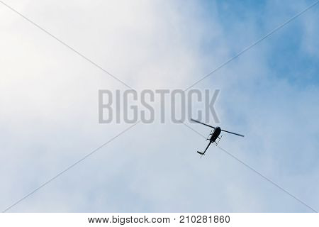 The Helicopter On The Blue Sky With Clouds