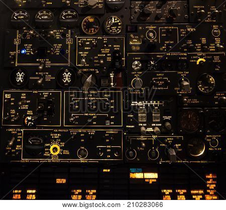 Control levers and switches with backlighting. Airplane cockpit.