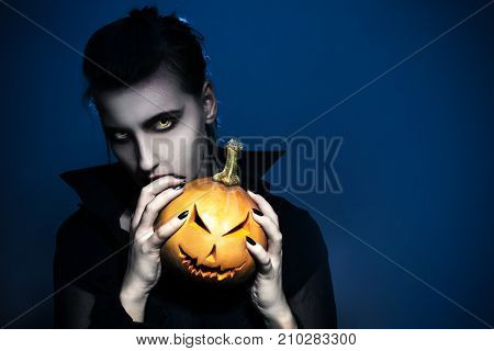 Halloween Werewolf Holding Grinning Face Pumpkin, Looking Mysterious Wild Eyes