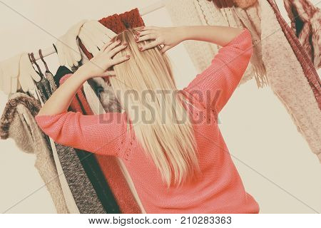 Woman In Wardrobe Choosing Clothing