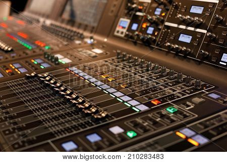 Close up of professional sound mixing console. Selective focus.