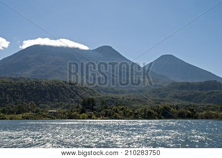 Lake Atitlan with volcanoes in background Guatemala