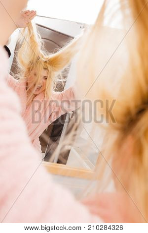 Woman Looking At Her Very Tangled Blonde Hair
