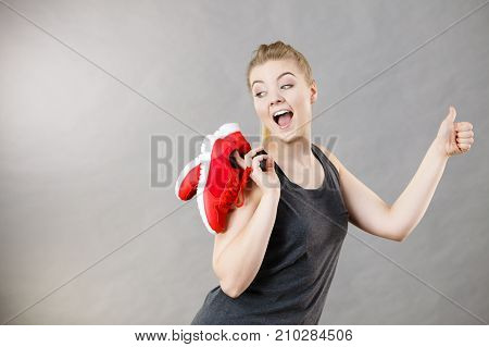 Happy Woman Presenting Sportswear Trainers Shoes