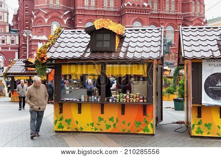 MOSCOW, RUSSIA - OCTOBER 06, 2016: Street shops in the center of Moscow in the autumn festive decoration. Moscow is the capital and most populous city of Russia with status of a Russian federal city.