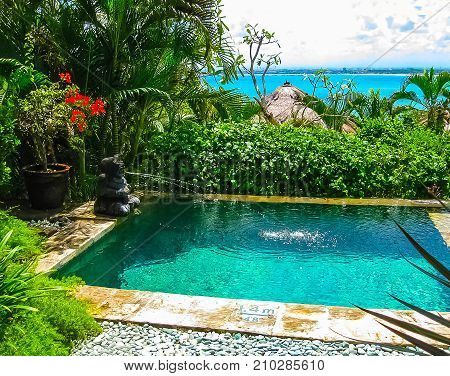 Jimbaran, Bali, Indonesia - April 14, 2014: View of the pool at Four Seasons Resort Bali at Jimbaran Bay