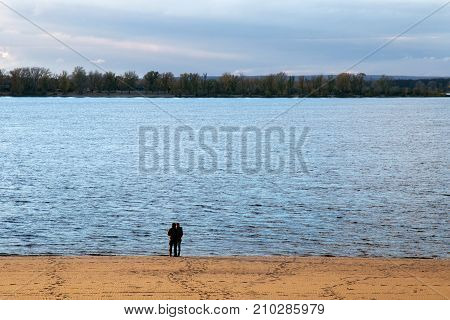 SAMARA, RUSSIA - OCTOBER 12, 2016: Unknown man and woman on an autumn evening on the coast of the Volga River in Samara.The city is situated on the east bank of the Volga.