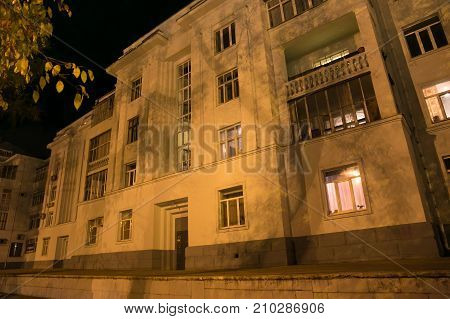Old historical building in constructivism style in the center of Samara (former Kuybyshev) on an autumn night. Samara is the sixth largest city in Russia.