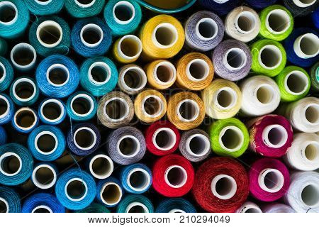 colorful thread coils, beautiful colors, blue, purple, red, yellow, threads in a box