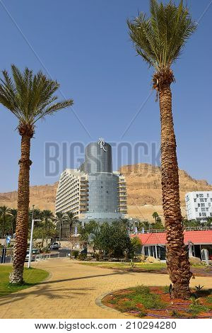 Dead Sea, Ein Bokek, Israel - october 19: landscape with palm trees on the background of luxury hotel, on october 19, 2017 in Ein Bokek, Dead Sea, Israe