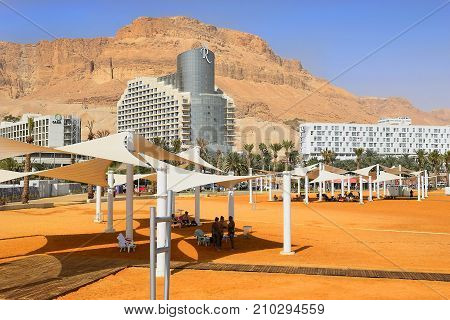 Dead Sea, Ein Bokek, Israel - october 19: vacationers and tourists bathe in the Dead Sea on the background of luxury hotels, on october 19, 2017 in Ein Bokek, Dead Sea, Israel