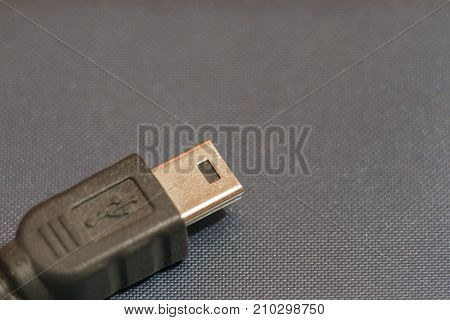 Micro USB connector for connecting to smartphone. There is space for text