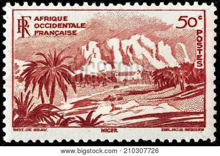 LUGA RUSSIA - NOVEMBER 29 2016: A stamp printed by FRENCH WEST AFRICA shows beautiful view of Oasis of Bilma in Niger circa 1947.